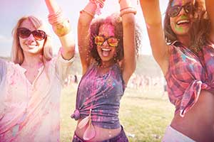 Girls covered in paint at a special event or festival