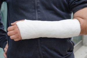 worker in a cast whose employer purchased workers compensation insurance