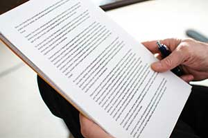 Business owner reading over details of his cannabis loss of income insurance policy