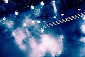 heavy clouds of smoke from a fog machine at a concert where the venue complained and sued the band but they are protected under an errors and omissions insurance package