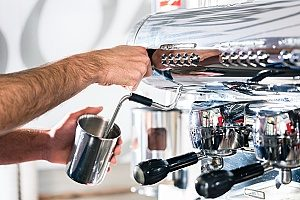 espresso being made from a coffee machine that frequently breaks down so the business will contact an entertainment insurance agency to discuss purchasing a policy