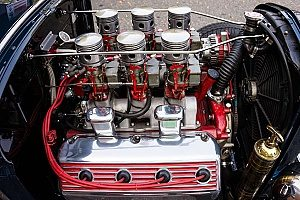 the engine of a muscle car that is being displayed at a car show that could benefit from special event insurance