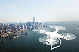 a quadcopter flying across New York City in order to capture a documentary that is being filmed by a company with drone insurance
