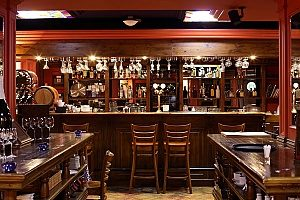 a picture of a bar within a restaurant that msut be covered by a strong liquor liability insurance policy since they regularly have guests coming in that argue