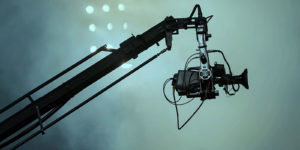 a very expensive film camera on a crane that is covered by production insurance since the film company spoke with entertainment insurance brokers