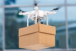 a drone carrying a package which can be a liability so the drone company has purchased drone insurance from reputable entertainment insurance brokers