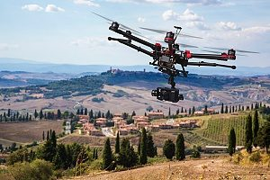 a drone flying over a rural area that is protected by entertainment insurance brokers during the set of a Hollywood movie