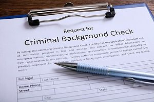 a request for an employee background check that was recommended to a company by business insurance brokers in order to prevent embezzlement in the future