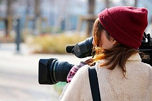 a camera woman who is being protected under production insurance for liability protection