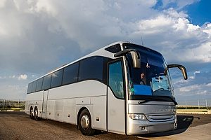 a coach bus that is transporting a film crew and therefore must have travel accident and production insurance policies