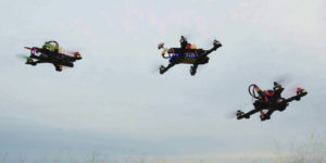 drones flying next to each other during a race that is covered by drone insurance for liability protection during the event