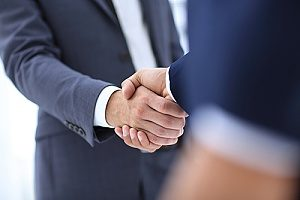 special event insurance broker shaking hands with a music festival company owner