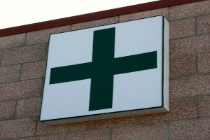 Medicinal marijuana dispensary with a green cross on the storefront