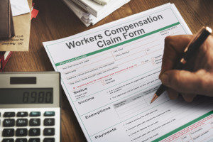 Technology firm worker filling out a workers compensation claim form