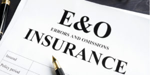 A stack of papers with E&O Insurance written on it