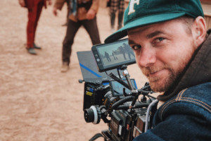 a cameraman holding a camera on a film production set that has film production insurance