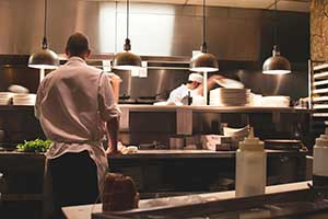 cooks in the kitchen of a restaurant protected by restaurant insurance