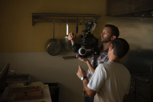 two men fixing a camera for a film production without film production insurance