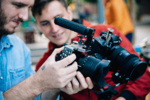 two people looking at a video camera on a film set that has film production insurance