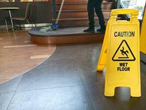 wet floor sign in resturant with restaurant insurance