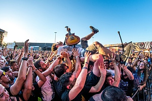 singer surfing the crowd that is a potential liability without concert insurance