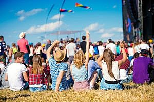 teenagers at a music festival that has festival insurance