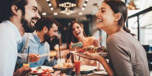 group-of-friends-eating-at-a-restaurant-with-the-benefits-of-restaurant-liability-insurance