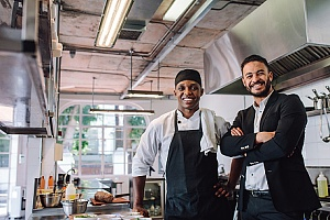 two restaurant owners getting the benefits of restaurant liability insurance