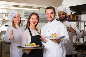 happy restaurant workers because of special event insurance