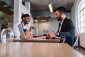 insurance broker discussing the benefits of assault & battery insurance for restaurants