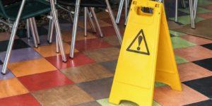 warning sign representing restaurant liabilities