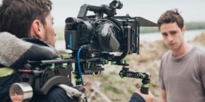 a-person-filming-with-a-camera-with-film-equipment-insurance
