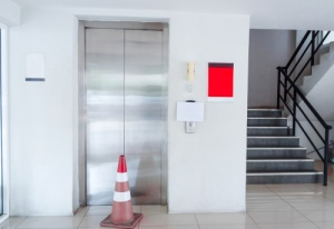 Business that has equipment insurance for their broken elevator