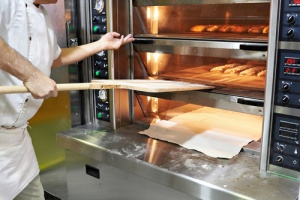 Man who has equipment insurance for his bakery oven