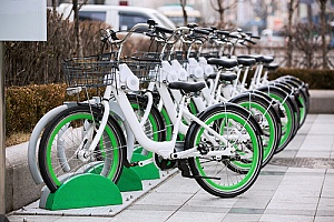app rental bikes lined up in a city