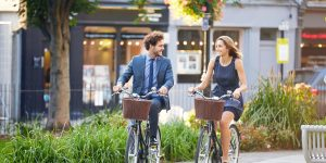 business individuals riding bikes in the city representing micromobility