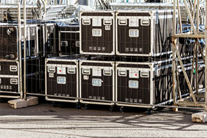 tour equipment in black containers