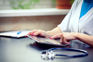 Doctor using tablet in hospital