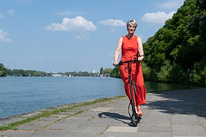 Woman on micromobility scooter