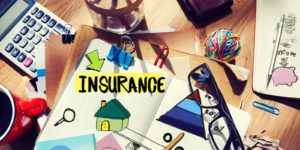 property insurance motifs shown on a desk with a calculator and coffee mug.jpg