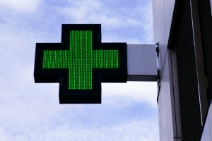 cannabis dispensaries with their green plus medical sign on
