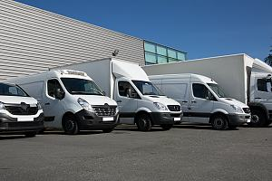 Commercial vehicles outside building