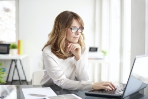 women looking up technology insurance
