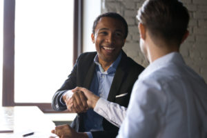 production company representative shakes the hand of an entertainment insurance agent