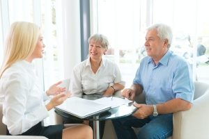 older couple learning the benefits of whole life insurance