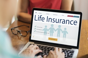 computer looking up term vs whole life insurance pros and cons