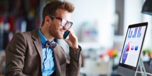 tech worker talks to a technology insurance broker on the phone about acquiring a policy