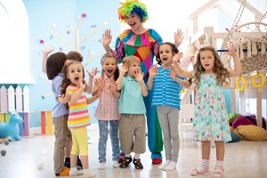 clown and children group playing indoor