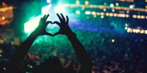 heart shaped hands at concert