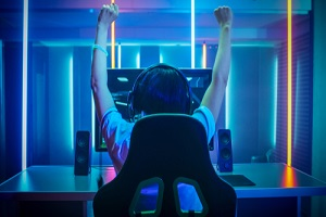 professional gamer playing and winning in first person shooter online video game